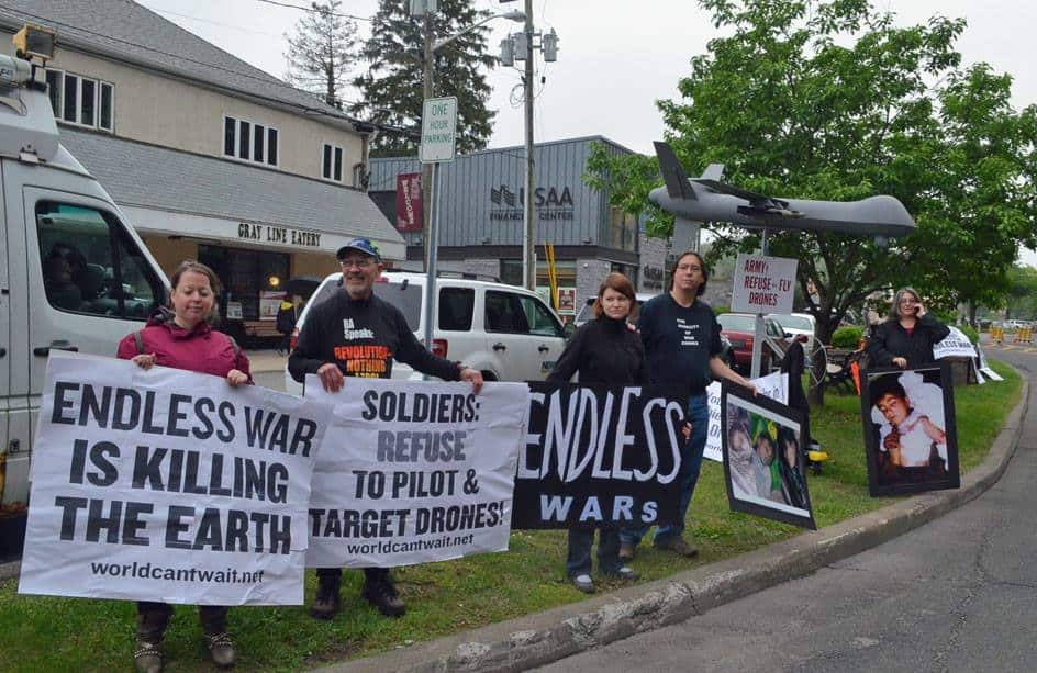 Groups of protesters gathered at the two main entrances of West Point May 28 to protest U.S. wars, and to specifically call on graduating Army officers to refuse to pilot and operate surveillance and weaponized drones. Photo: Don Emmert