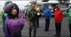 """President George W. Bush in a flight suit after landing on the USS Abraham Lincoln to give his """"Mission Accomplished"""" speech about the Iraq War, May 1, 2003. (U.S. Navy photo)"""
