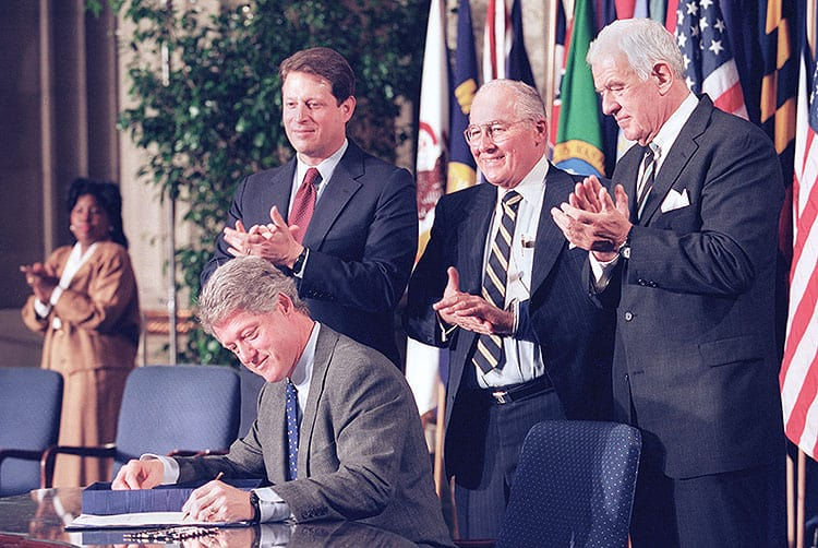 President Clinton signs legislation implementing the North American Free Trade Agreement on December 8, 1993