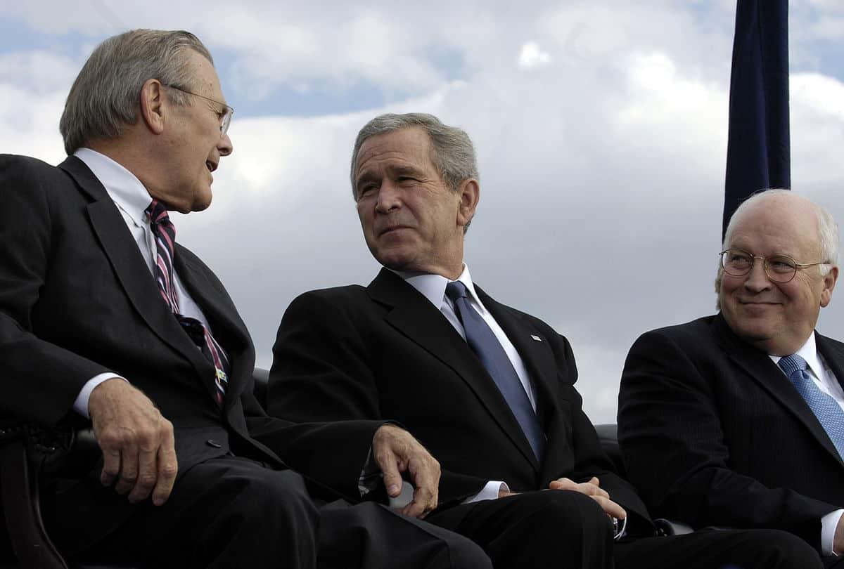Rumsfeld, Bush, and Cheney enjoying themselves.