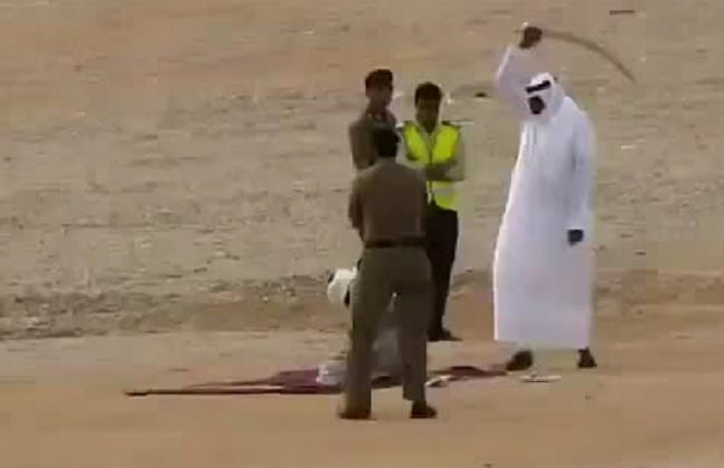 An image grab from an undated video posted to LiveLeak.com shows a Saudi executioner raising his sword before beheading a convict.